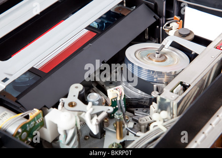 Interior of a VCR with a cassette inserted and playing - Stock Image