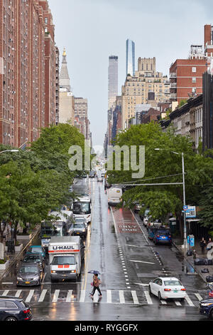 New York, USA - June 28, 2018: Street in the New York City on a rainy day. - Stock Image