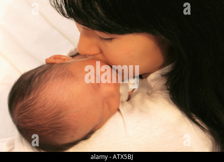 'overhead view' of Asian woman kissing her infant son - Stock Image