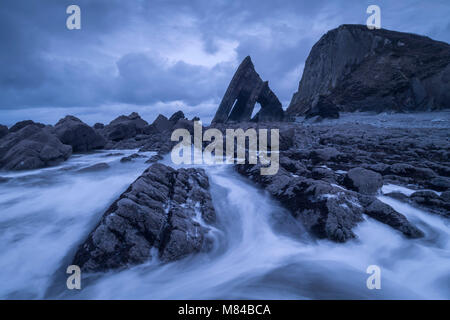 Dramatic coastal scenery with Blackchurch Rock at Mouthmill Cove on the North Devon coast, England. Winter (February) - Stock Image