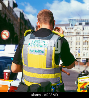 Rear view of paramedic remote ambulance worker in the London Ambulance Service at Liverpool Street Station in London, England, UK KATHY DEWITT - Stock Image