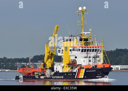 Boytender Scharhoern leaving the port of Kiel - Stock Image