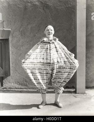 Clown wearing wide costume - Stock Image