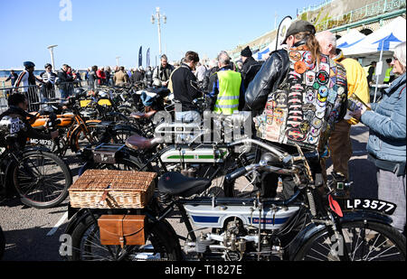 Brighton, UK. 24th March 2019. Visitors enjoy the 80th Anniversary Pioneer Run for pre 2015 veteran motorcycles in Brighton . The run organised by the Sunbeam Motor Cycle Club begins on the Epsom Downs in Surrey and finishes on Madeira Drive on Brighton seafront Credit: Simon Dack/Alamy Live News - Stock Image