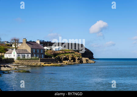 Bay Cafe, caravan park and coastal footpath on rocky coast overlooking the sea. Benllech, Isle of Anglesey, North Wales, UK, Britain - Stock Image