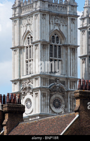 Westminster Abbey seen over the rooftops of Victorian terraced houses - Stock Image