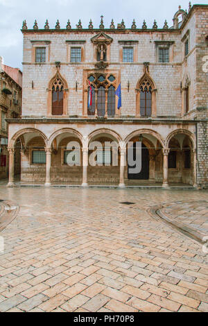 Sponza Palace in Dubrovnik with flag of Croatia and European Union. Sponza Palace was built in 16th century. - Stock Image