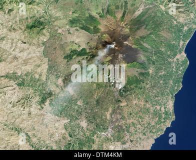 Smoking Mt. Etna volcano - Stock Image