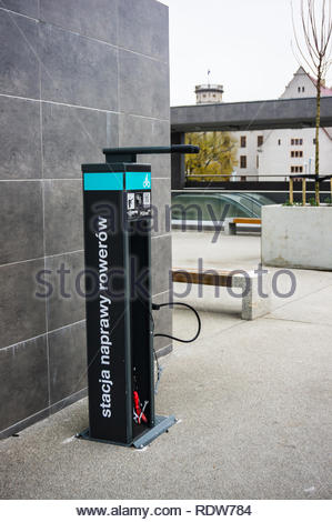 Poznan, Poland - November 21, 2018: Public bike and buggy repairing spot with many tools and air pump at the Kaponiera passage in the city center. - Stock Image