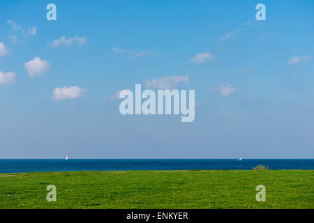 Grass, Sea and blue sky in Malmo, Sweden - Stock Image
