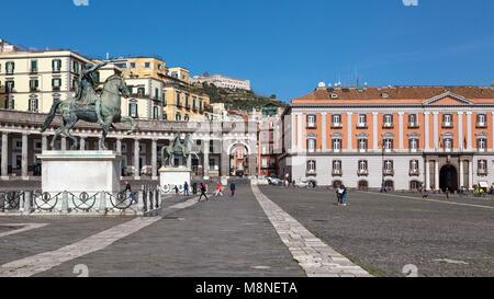 Naples (Italy) - Piazza Plebiscito, the main square in the historic centre of Naples. Two equestrian statues stand - Stock Image