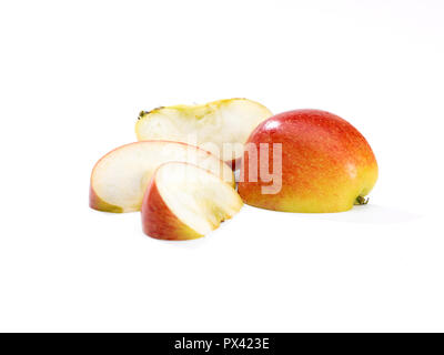 an apple s;iced and in segments on a white background - Stock Image
