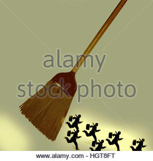 Businessmen running away from sweeping broom - Stock Image