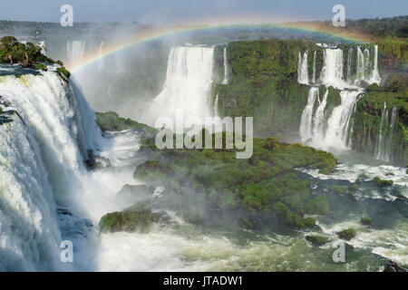 Rainbow over the Iguazu Falls, viewed from the Brazilian side, UNESCO, Foz do Iguacu, Parana State, Brazil - Stock Image