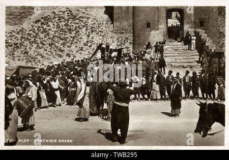 Citadel, Aleppo, Syria - Arab Play with musicians and spectators.     Date: 1923 - Stock Image