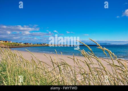 The sandy beach of village  Ekkerøy at Varangerfjorden in arctic Norway. - Stock Image