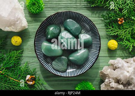 Green Aventurine Stones with Smoky Quartz and Greenery - Stock Image