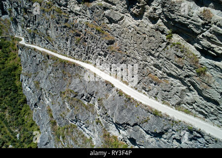 Road into Skippers Canyon at Pinchers Bluff, near Queenstown, South Island, New Zealand - aerial - Stock Image