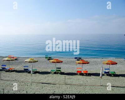 Beach chairs and umbrellas, Italy - Stock Image