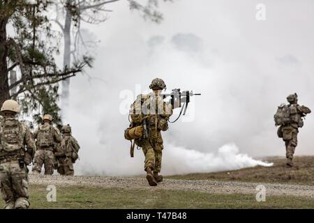 U.S. Army Soldiers assigned to Bravo Company, 3rd Battalion, 187th Infantry Regiment, 3rd Brigade Combat Team, 101st Airborne Division (Air Assault), clear an urban environment during brigade live fire exercise at Fort Polk, La. Mar.11, 2019. - Stock Image