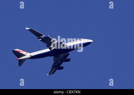 British Airways Boeing 747 G-BNLV in flight : clear sky - Stock Image