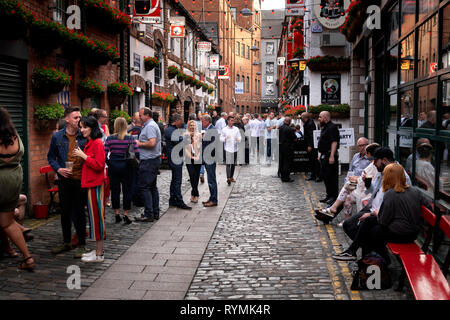 People drinking outside the Duke of York pub in summer - Stock Image