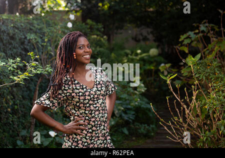 An African woman standing in a garden - Stock Image