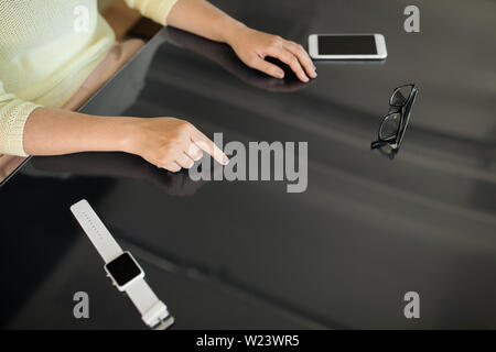 close up of woman using black interactive panel - Stock Image