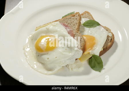 A shot of two sandwiches with bread and fried egg - Stock Image