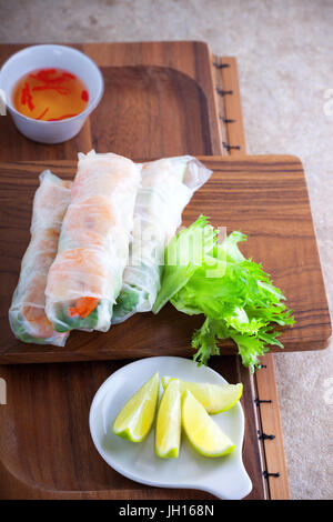 Vietnamese rice paper rolls with prawn and vegetables. - Stock Image