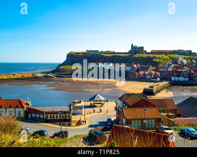 Whitby harbour with cottages on the east side of town and the 199 steps from the quayside to St Mary's church - Stock Image