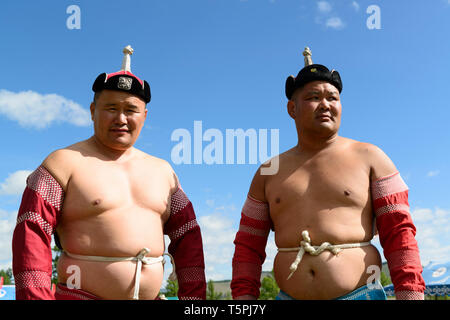 Naadam Festival in Khatgal, Mongolia. Wrestling competition. Two wrestlers - Stock Image
