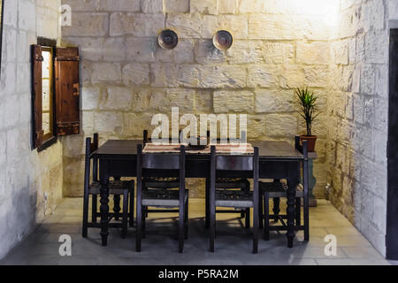 Traditional Maltese dining table in a house. - Stock Image