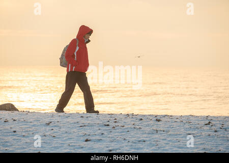 Ferring west Sussex, UK. Friday 1 st Febuary. UK weather. After moderate snowfall last night Ferring wakes to snow covered beaches. Credit: Photovision Images News/Alamy Live News - Stock Image