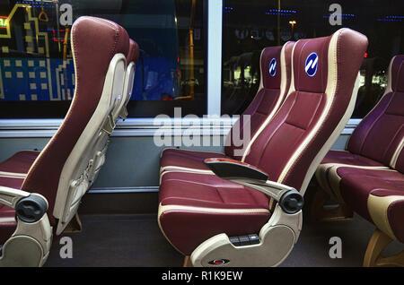 Comfortable reclining seats of Royal Trans bus - Stock Image