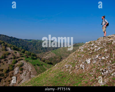 Peak District National Park, Derbyshire, UK. 10th October, 2018. UK Weather a man admiring the view on the top of Thorpe Cloud on a unusually hot sunny October day in the tourist hotspot of Dovedale in the Peak District National Park, Derbyshire Credit: Doug Blane/Alamy Live News - Stock Image