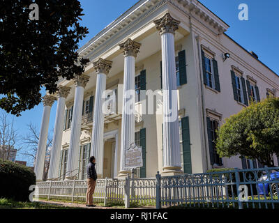 Murphy House, a Greek revival home build in 1851 is visited by a tourist in Montgomery Alabama, USA. - Stock Image