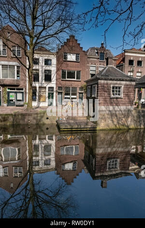 Netherlands, Gouda, 2017, The famous facades from the dutch town of Gouda. With it's red brick constructions and large windows. - Stock Image
