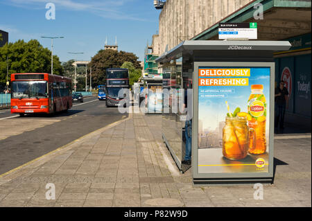 JCDecaux roadside bus stop billboard site advertising Lipton iced tea in Plymouth Devon England UK - Stock Image