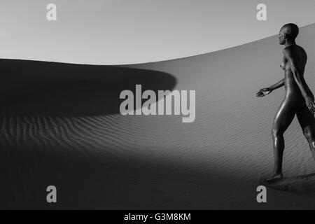 Nude woman walking in desert - Stock Image