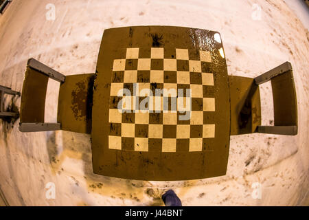 Outdoor chess board with 2 chairs in winter - Stock Image