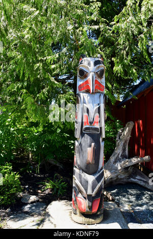 Carved totem near the Port Renfrew Hotel on Vancouver Island, BC, Canada - Stock Image