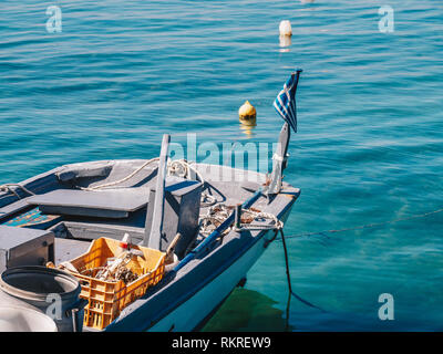 Detail view of a traditional greek fishing boat with Greek Flag in Limenas Port, Thasos Island - Stock Image