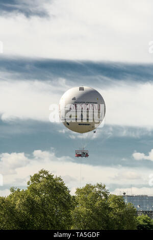 The Ballon Generali is a tethered helium balloon, used as tourist attraction and advertising support. Installed in Paris since 1999 in the Parc André- - Stock Image