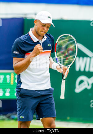 Eastbourne, UK. 25th June, 2019. Jay Clarke of Great Britain in action against Leonardo Mayer of Argentina during their match at the Nature Valley International tennis tournament held at Devonshire Park in Eastbourne . Credit: Simon Dack/Alamy Live News - Stock Image