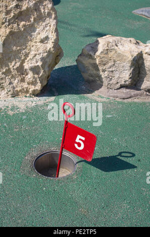 Putting Green Crazy Golf UK hole - Stock Image