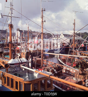1960s, Scottish highlands, wooden fishing boats in the harbour at Stornoway. - Stock Image