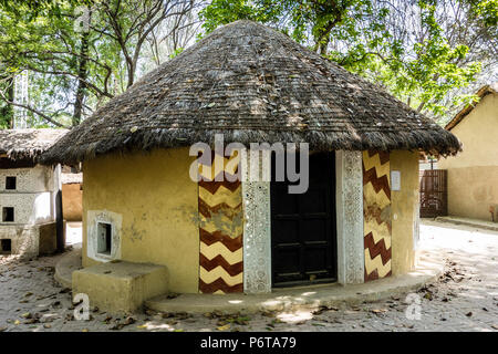 Exhibit of a circular Banni hut thatched with local weeds and the shape protects from desert winds, National Crafts Museum, New Delhi, Delhi, India - Stock Image
