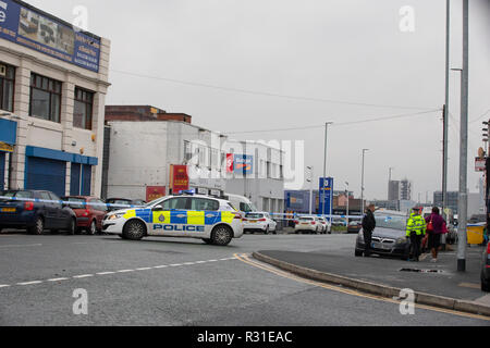Leeds, UK. 21st Nov 2018.. Police on Roseville Road in Leeds where a 71 year old pedestrian was left with serious injuries after being hit by an unmarked police car.  The road remains closed this evening whilst policy continue their investigations Credit: James Copeland/Alamy Live News - Stock Image