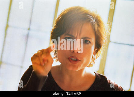 Angry young woman pointing finger, USA - Stock Image